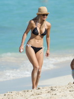 Elin Nordegren busty wearing tiny black bikini at the beach in Bahamas from CelebMatrix