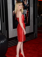 Emma Stone looks hot wearing short strapless red dress at Gangster Squad premiere in LA from CelebMatrix