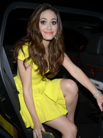 Emmy Rossum cleavy and leggy in yellow mini dress arriving at Dior's Hollywood glamour dinner at the Chateau Marmont  from CelebMatrix