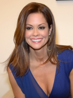 Brooke Burke cleavy and leggy wearing blue mini dress at her new workout DVD promotion in Santa Monica from CelebMatrix