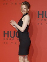 Renee Zellweger looks hot wearing black backless mini dress at the Hugo Boss fashion show in Berlin from CelebMatrix