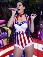 Katy Perry busty and leggy wearing skimpy national colored costume at a concert in Washington D.C. from CelebMatrix
