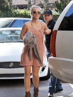 Britney Spears bralles wearing flowing mini dress while visits her friend in Los Angeles from CelebMatrix