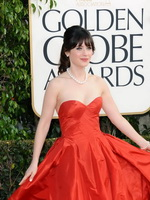 Zooey Deschanel busty wearing red strapless maxi dress at Golden Globe awards 2013 from CelebMatrix