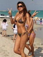 Aida Yespica busting out in tiny bikini at the beach in Miami from CelebMatrix