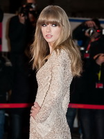 Taylor Swift cleavy and leggy wearing tight mini dress at NRJ Music Awards 2013 in Cannes from CelebMatrix