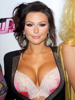 Jenni Farley showing her big assets in lace bra under a wide open jacket at the RuPaul's Drag Race event from CelebMatrix