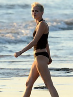 Miley Cyrus working out in bikini at the beach in Hawaii from CelebMatrix