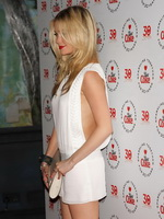 Laura Whitmore braless showing pokies in a tiny white mini dress at  the Diet Coke 30th birthday party in London from CelebMatrix