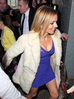 Geri Halliwell upskirt wearing a low cut purple mini dress while arriving for the Viva Forever cocktail launch at Harvey Nichols in London from CelebMatrix