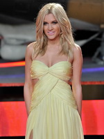 Ashley Roberts busty  leggy wearing yellow tube high slit dress at A Good Day To Die Hard premiere in London from CelebMatrix