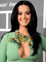 Katy Perry showing epic cleavage in a tight green dress at 55th Annual Grammy Awards in Los Angeles from CelebMatrix