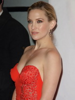 Kate Hudson showing huge cleavage in a red bare back maxi dress at the Elle Style Awards in London from CelebMatrix