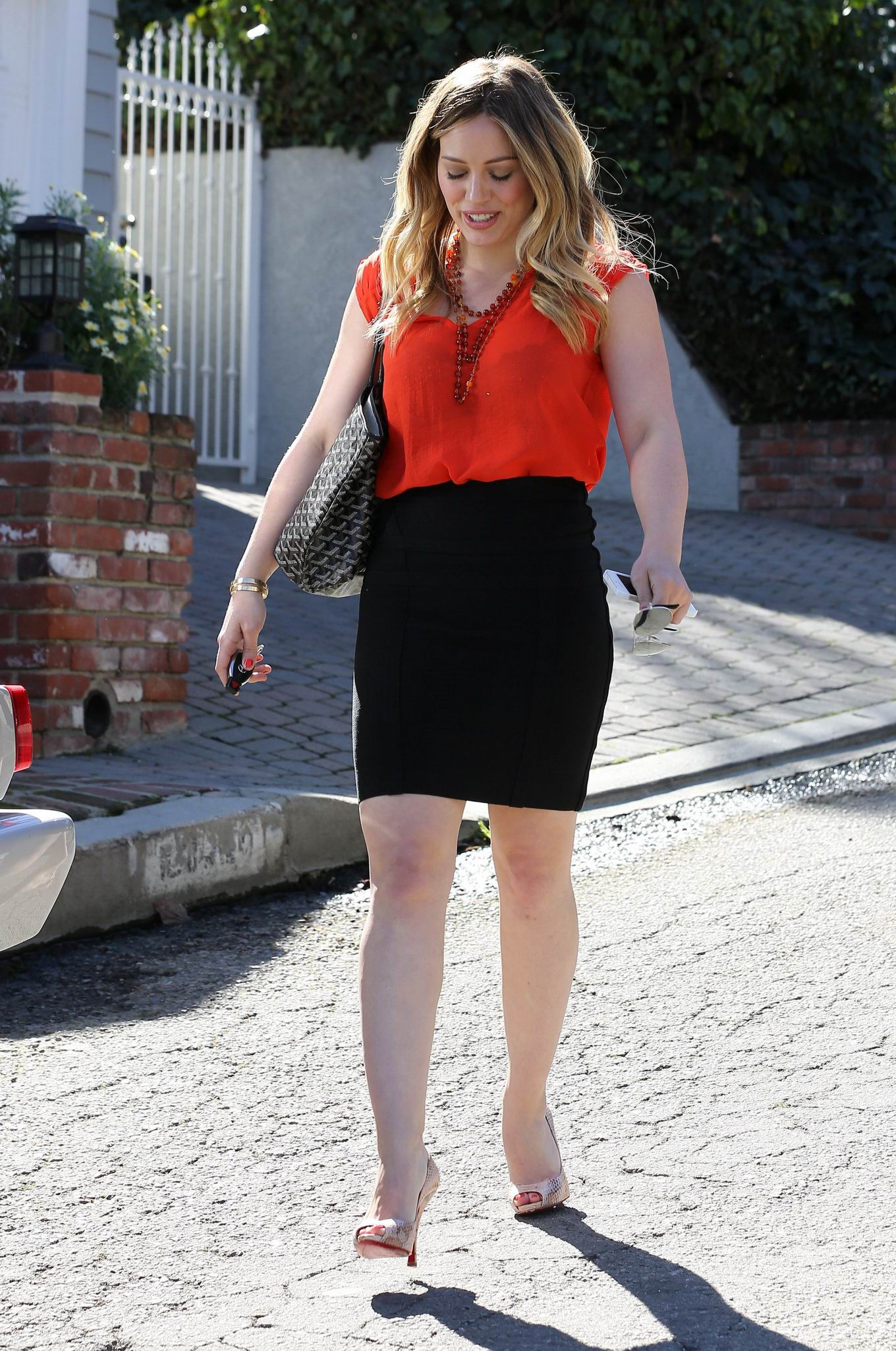 ... wearing red see-through to bra top black mini skirt out in Studio City