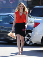 Hilary Duff busty wearing red see-through to bra top  black mini skirt out in Studio City from CelebMatrix