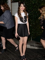 Miranda Cosgrove leggy wearing tiny black mini dress and broken heart top at the Topshop Topman opening party in Los Angeles from Mr Skin