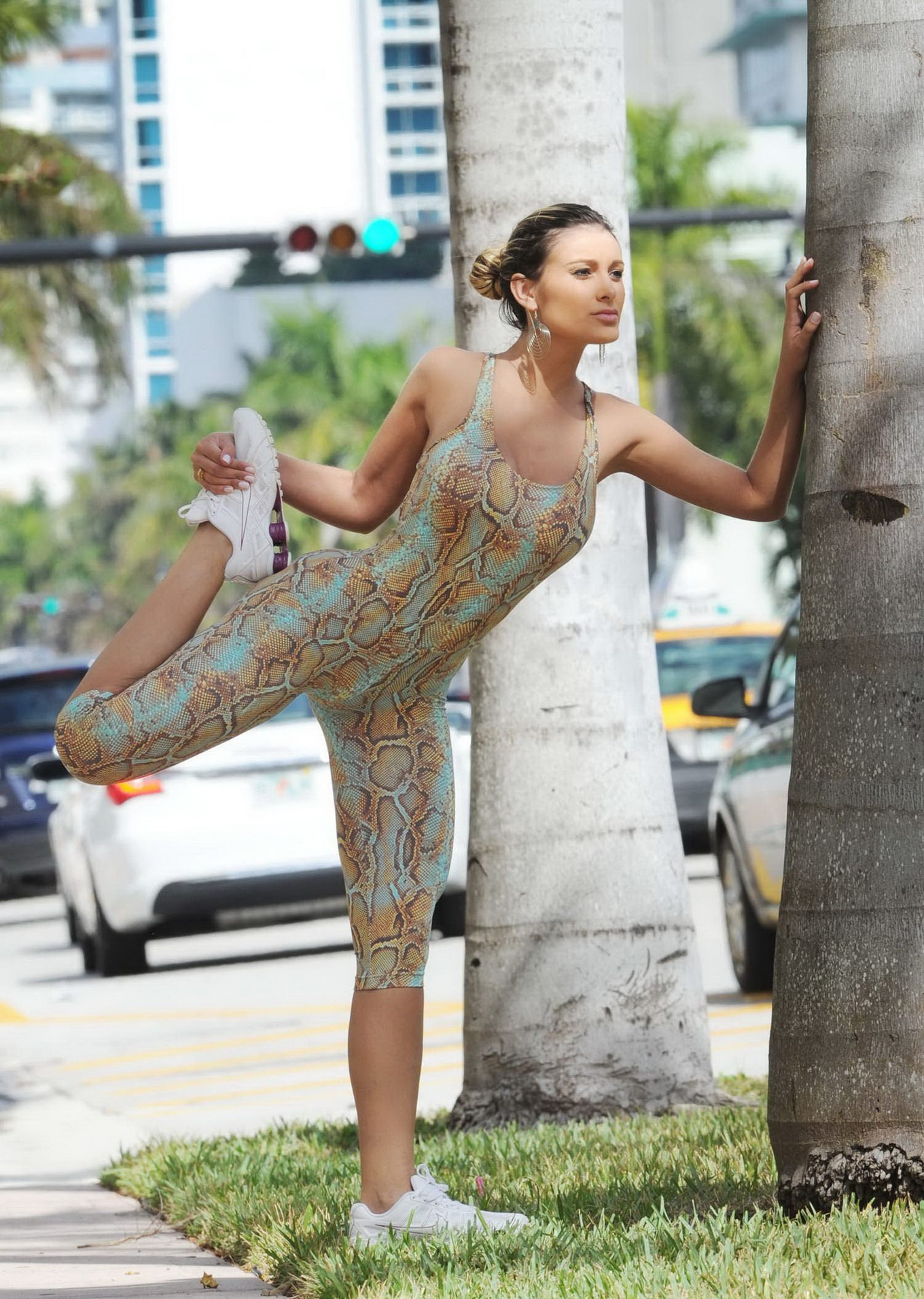 Andressa Urach bursting out of snake print leotard while working out ...