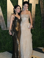 Selena Gomez and Vanessa Hudgens showing their cleavages at Vanity Fair Oscar Party in West Hollywood from Mr Skin