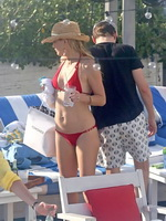 Kate Hudson wearing skimpy red bikini poolside in Miami from CelebMatrix