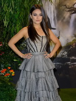 Mila Kunis looks very hot wearing strapless gray dress at Oz the Great and Powerful premiere in London from CelebMatrix