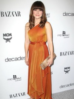 Sophia Bush braless wearing hot orange dress at Bravo's Dukes of Melrose launch in Los Angeles from CelebMatrix