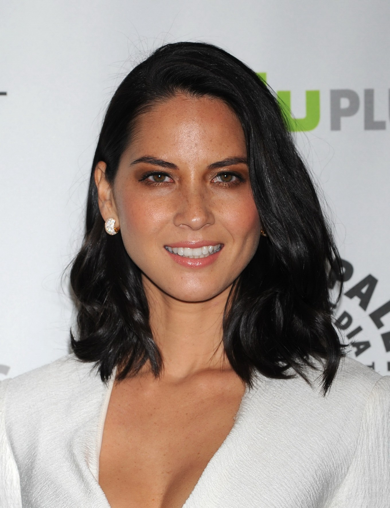Olivia Munn leggy showing cleavage in white low cut mini ...