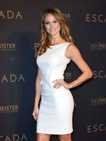 Stacy Keibler wearing tight white mini dress at the Escada Flagship store grand opening in Berlin from CelebMatrix