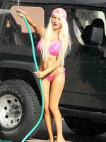 Courtney Stodden bursting out of wet pink bikini while washing her jeep from CelebMatrix