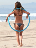 Audrina Patridge in bikini working out with hula hoop at a beach in LA from CelebMatrix