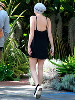 Miley Cyrus braless wearing black backless mini dress at a Recording Studio in Hollywood from CelebMatrix