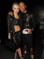 Miley Cyrus wears black belly top and leather shorts at Pharrell Williams's birthday party in Miami from CelebMatrix