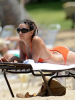 Eva Longoria showing off her curvy body in orange bikini at the beach in Puerto Rico from CelebMatrix