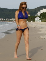 Lindsay Lohan bursting out of her soppy blue bikini at a beach in Brazil from CelebMatrix