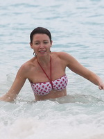 Dannii Minogue showing off her curvy body in a tube bikini at some Caribbean beach from CelebMatrix