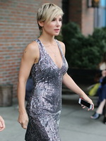 Elsa Pataky braless showing huge cleavage in a shiny gray backless mini dress at Oceana's Inaugural Ball at Christie's in NYC from CelebMatrix