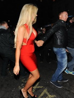 Frankie Essex upskirt and cleavy in a red low cut mini dress with Chloe Sims outside the Nobu restaurant in Mayfair from CelebMatrix