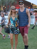 Paris Hilton braless showing huge cleavage in a colorful mini dress at 2013 Coachella Music Festival in Palm Springs from CelebMatrix