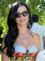 Katy Perry wearing folk designed bikini top and mini skirt at the Lacoste pool party in Palm Springs from CelebMatrix