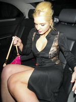Helen Flanagan braless wearing black transparent low cut mini dress out of Riverside Studio in London from CelebMatrix