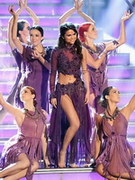 Selena Gomez showing off her amazing body in a skimpy purple see-thru dress at Dancing With The Stars show from CelebMatrix