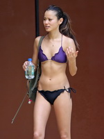 Jamie Chung wearing tiny wet bikini at the beach during a vacation in Hawaii from CelebMatrix