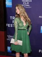 Sasha Pieterse showing big cleavage in a short green transparent dress at the Tribeca Film Festival in NYC from CelebMatrix