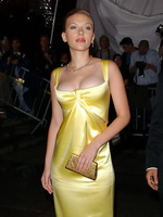 Scarlett Johansson braless showing epic cleavage in a yellow Calvin Klein dress at the Costume Institute Gala from CelebMatrix
