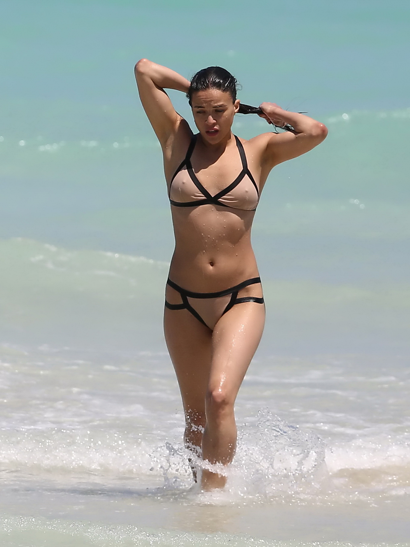 Michelle Rodriguez showing off her wet body in a flesh ...