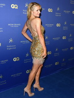 Paris Hilton wearing tiny golden mini dress at Grand opening of the Hakkasan Nightclub in Las Vegas from CelebMatrix