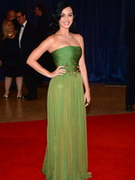 Katy Perry wearing green strapless maxi dress at White House Correspondents' Association Dinner in Washington from CelebMatrix