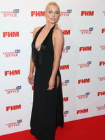 Helen Flanagan showing huge cleavage in a black low cut and high slit dress at FHM Sexiest Women Awards from CelebMatrix