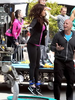 Megan Fox cleavy wearing tight outfit while jumps on trampoline at the TMNT set from CelebMatrix