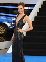 Gal Gadot braless showing huge cleavage in a shiny black dress at Fast And Furious 6 premiere in London from CelebMatrix