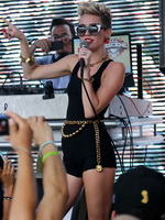 Miley Cyrus wearing tight black bodysuit at the Y100 Mack-A-Poolooza pool party in Miami from CelebMatrix